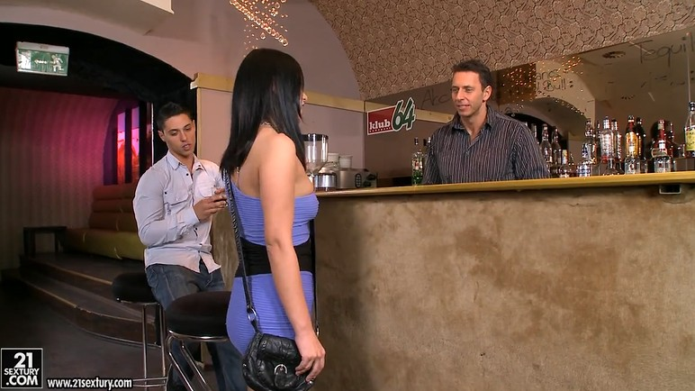 Two guys fuck a hot brunette in a bar