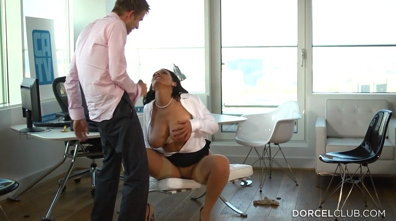 Mature milf fucks passionately in the office