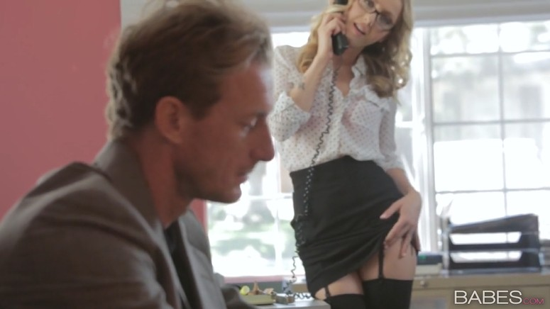 Milf in stockings seduces a man in the office
